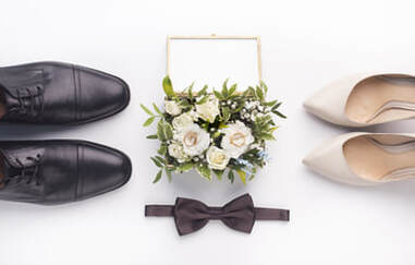 Grooms shoes, brides heels, pose in this simplistic shoot with our white rose bouquet